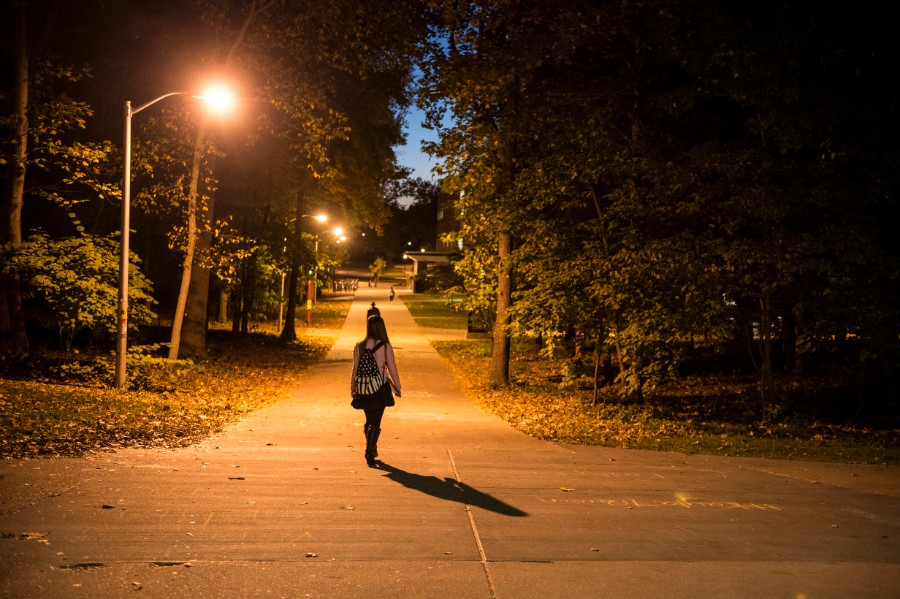 SIU student walking on campus at night