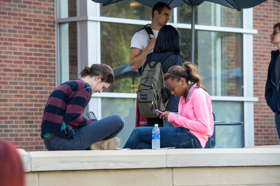 SIU students hanging out in front of  morris library